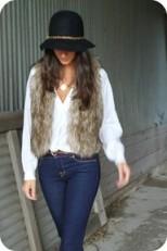 Woman in fur vest